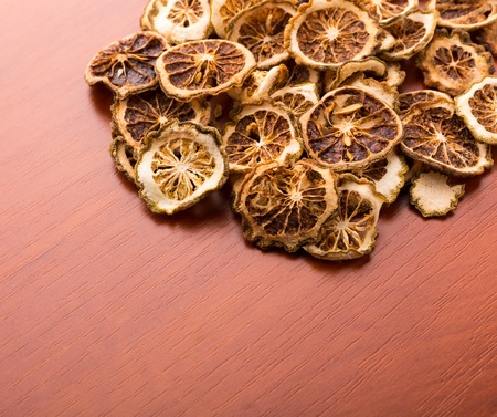 heartiness: Pile of dried lime slices on wooden table Stock Photo