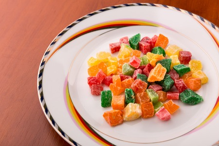 sugarcoated: Different colorful succade heap on white plate