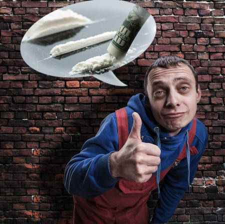 druggie: A man with thumb up hand sign thinking about drugs Stock Photo