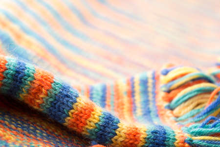 fringes: Knitted multicolored scarf with fringes