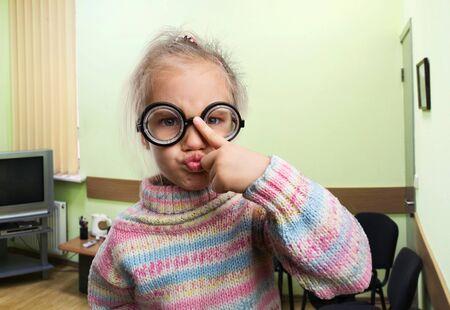 egghead: Egghead little girl in nerd glasses in the class Stock Photo