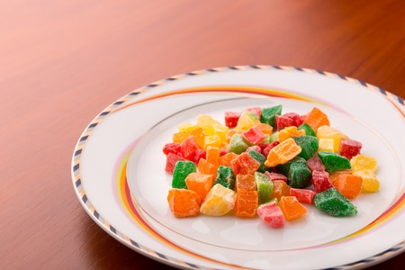 sugarcoated: Colorful succade heap on white plate Stock Photo