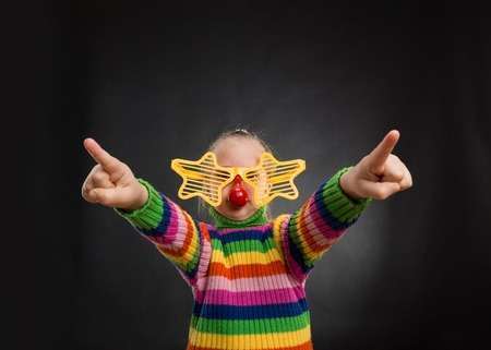 Little girl in funny starry party glasses photo