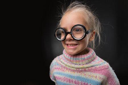 nerd girl: Little nerd girl in glasses makes faces