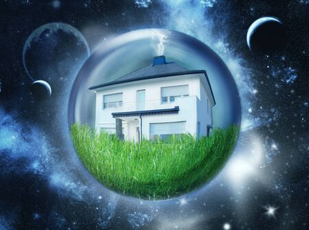 House with lawn in bubble hovering in space photo