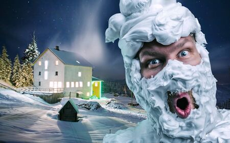 Surprised strange man with shaving foam on his face and on his head over winter background Stock Photo