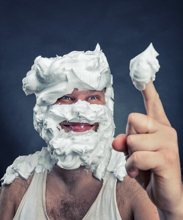 ugly man: Ugly man with whipped cream on his face is going to lick his finger