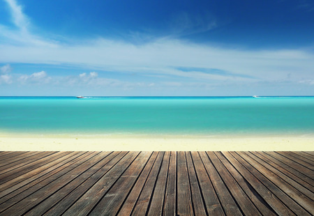 Wooden pier against tropical beach