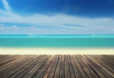 Wooden pier against tropical beach