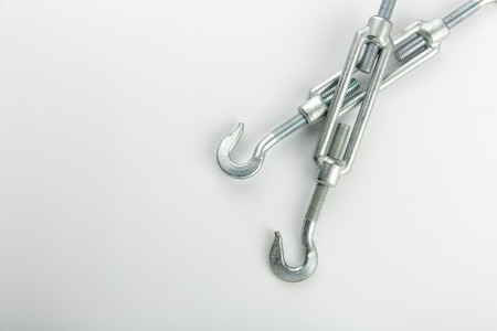 rappelling: Two industrial hooks on white