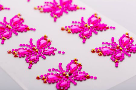 Butterfly symbols made of decorative gems macro photo