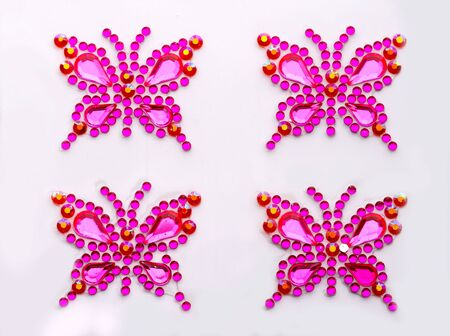 Butterfly symbols made of decorative gems isolated photo