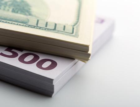 Packs of dollars and euros closeup photo