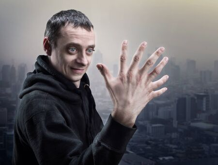 fear face: Surprised man looks at his palm with seven fingers
