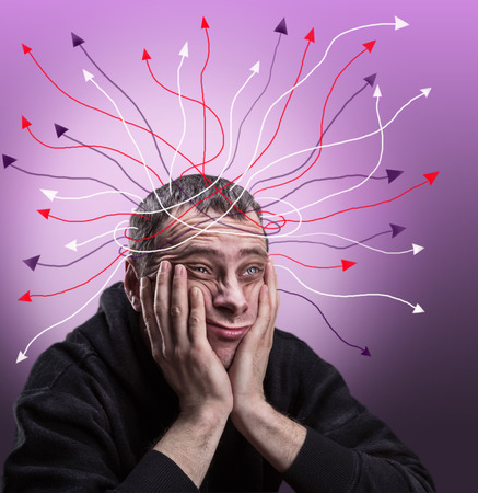 the cheeks: Depressed man with palms on his cheeks is thinking Stock Photo