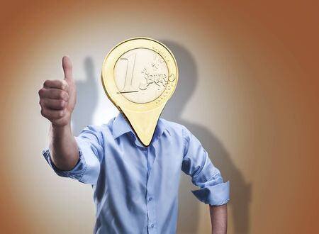 winning mood: Businessman with an euro coin instead of his head shows thumb up