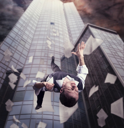 scattered: Businessman is falling down from the tall office building Stock Photo