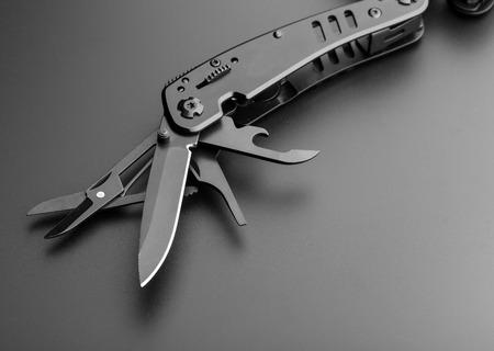 pocket knife: Closeup of black opened multitool knife Stock Photo