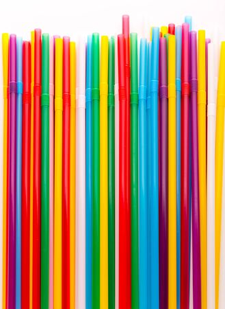Colorful drinking straws closeup background photo