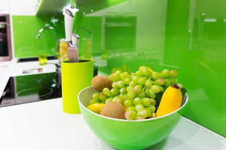interior shot: Modern green kitchen interior shot with grapes
