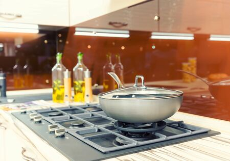 pot light: Stove with pan on the modern kitchen