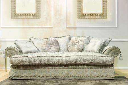 Luxury  interior with nice big white sofa photo