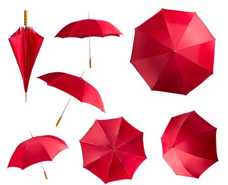 Paraguas rojos aislados sobre fondo blanco Foto de archivo - 38833970