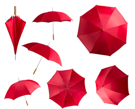 closed: Red umbrellas isolated on white background Stock Photo