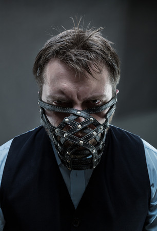 furious: Furious man in muzzle over grey