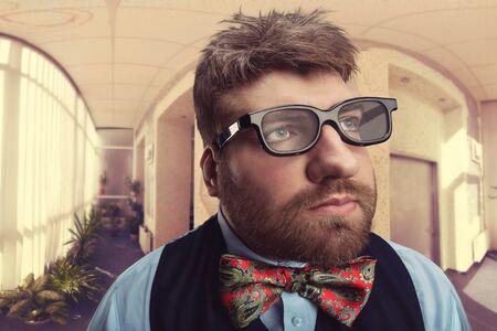bizarre: Office nerd in glasses looks aside