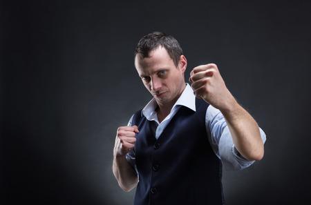 spite: Fighting businessman over grey background Stock Photo