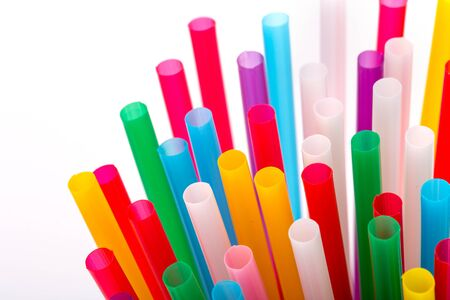 Colorful drinking straws on white photo