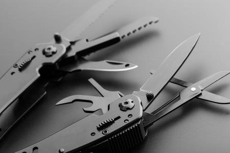 pocket knife: Black opened multitool knife closeup Stock Photo