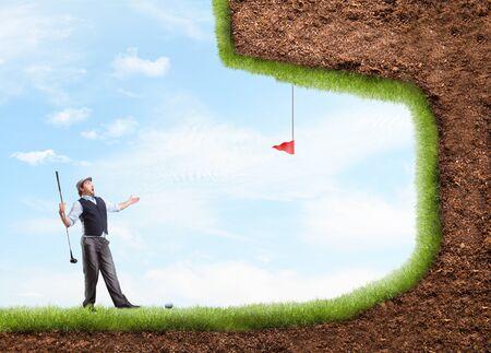 caddie: Businessman playing strange golf in open air