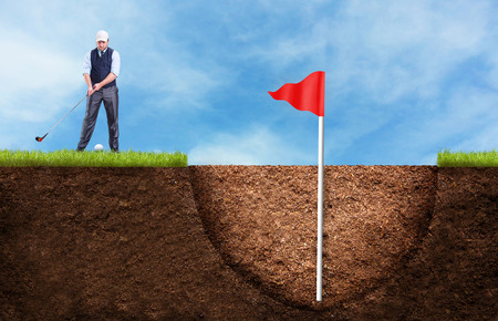 country club: Businessman is hitting the golf ball to the huge hole