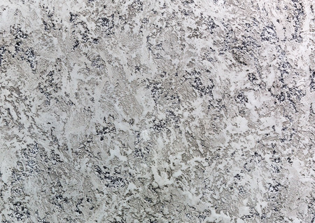 pitted: A grey wall with cracks of stucco Stock Photo