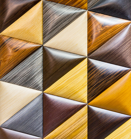 Wooden background consisting of triangle pieces photo