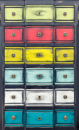 Retro wooden cupboard with multicolored drawers photo