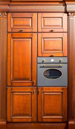 built: Kitchen wooden furniture with an oven built in