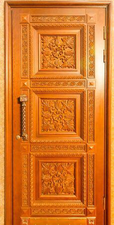 wood carving door: Facade of wooden door background