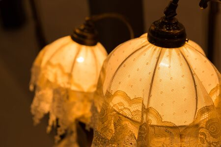 Vintage lamps closeup in yellow color photo