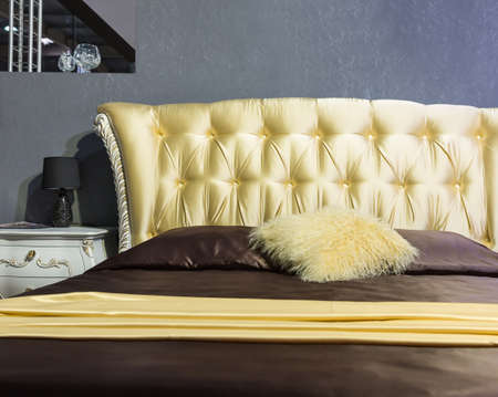 Classical luxury interior of bedroom. Closeup view of bed photo