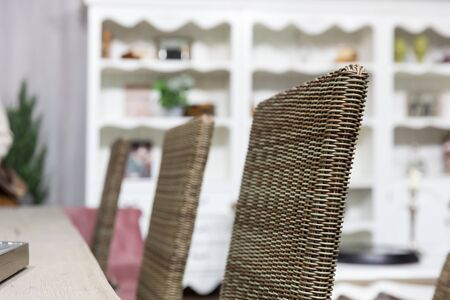 view an elegant wardrobe: Wicker chairs in home interior close up