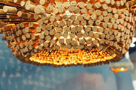 wood ceiling: Modern chandelier made of cork stoppers Stock Photo