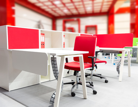 wooden furniture: Office workers place with modern interior in red tones