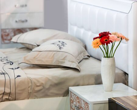 flower beds: Bouquet of flowers stands on the table in the bedroom