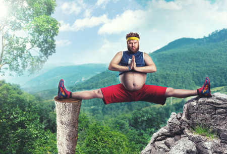 weightloss: Fat sportsman does the splits in the mountains