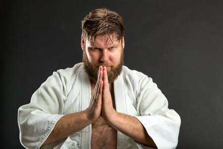 an obeisance: Closeup of bearded karate fighter doing bow