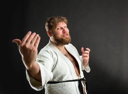 sensei: Bearded karate fighter in white kimono calls you to fight