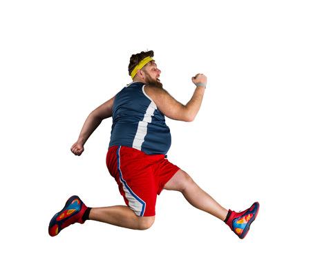白い背景の上実行している脂肪のスポーツマン